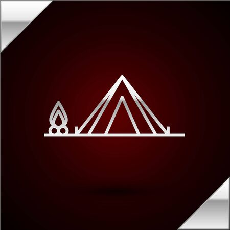 Silver line Tourist tent with wood fire icon isolated on dark red background. Camping symbol. Vector Illustration