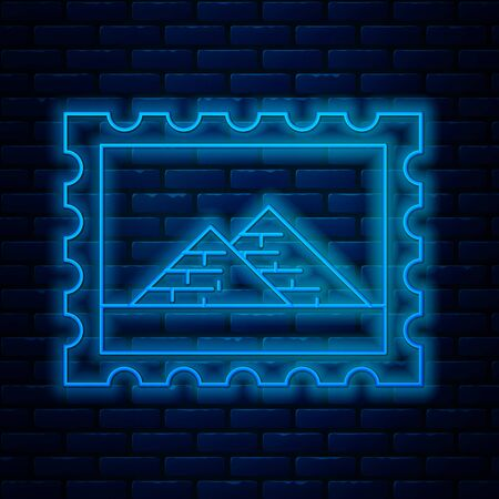 Glowing neon line Postal stamp and Egypt pyramids icon isolated on brick wall background. Vector Illustration