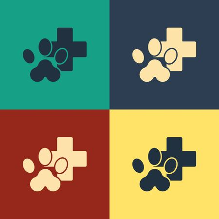Color Veterinary clinic symbol icon isolated on color background. Cross hospital sign. Stylized paw print dog or cat. Pet First Aid sign. Vintage style drawing. Vector Illustration