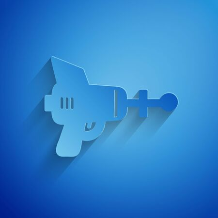 Paper cut Ray gun icon isolated on blue background. Laser weapon. Space blaster. Paper art style. Vector Illustration