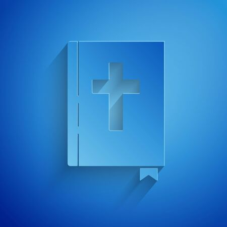 Paper cut Holy bible book icon isolated on blue background. Paper art style. Vector Illustration