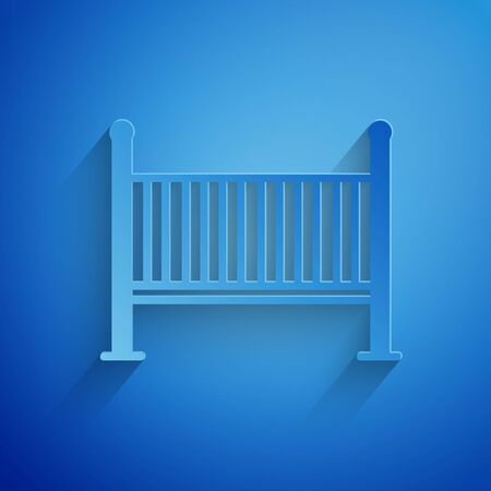 Paper cut Baby crib cradle bed icon isolated on blue background. Paper art style. Vector Illustration