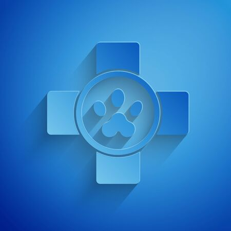 Paper cut Veterinary clinic symbol icon isolated on blue background. Cross hospital sign. Stylized paw print dog or cat. Pet First Aid sign. Paper art style. Vector Illustration
