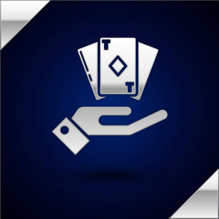 Silver Hand holding deck of playing cards icon isolated on dark blue background. Casino gambling.  Vector Illustration