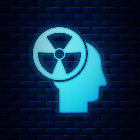 Glowing neon Silhouette of a human head and a radiation symbol icon isolated on brick wall background. Vector Illustration