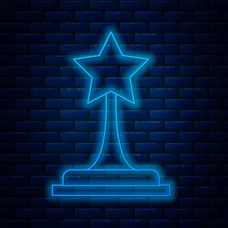 Glowing neon line Movie trophy icon isolated on brick wall background. Academy award icon. Films and cinema symbol. Vector Illustration