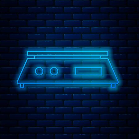Glowing neon line Electronic scales icon isolated on brick wall background. Weight measure equipment. Vector Illustration