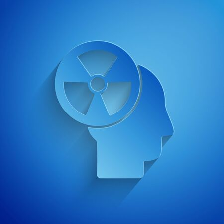 Paper cut Silhouette of a human head and a radiation symbol icon isolated on blue background. Paper art style. Vector Illustration