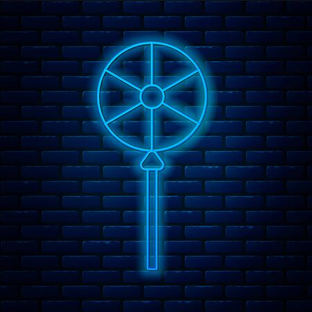 Glowing neon line Lollipop icon isolated on brick wall background. Food, delicious symbol. Vector Illustration