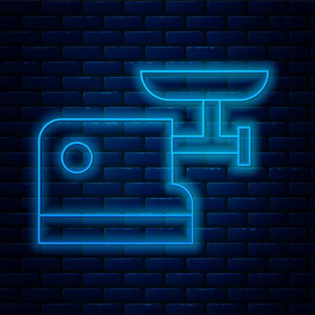 Glowing neon line Kitchen meat grinder icon isolated on brick wall background. Vector Illustration