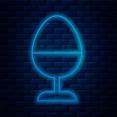 Glowing neon line Chicken egg on a stand icon isolated on brick wall background. Vector Illustration