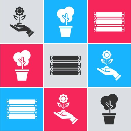 Set Hand holding flower, Tree in pot and Wooden box icon. Vector