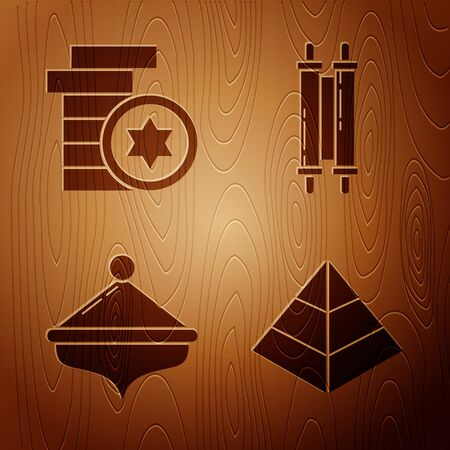 Set Egypt pyramids, Jewish coin, Hanukkah dreidel and Torah scroll on wooden background. Vector