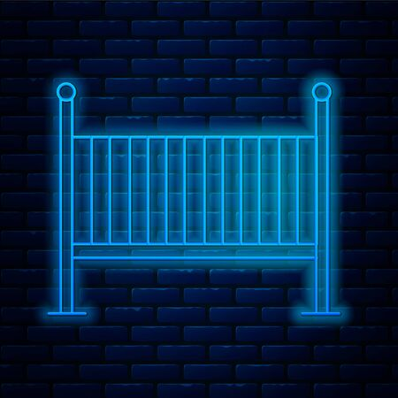 Glowing neon line Baby crib cradle bed icon isolated on brick wall background. Vector Illustration
