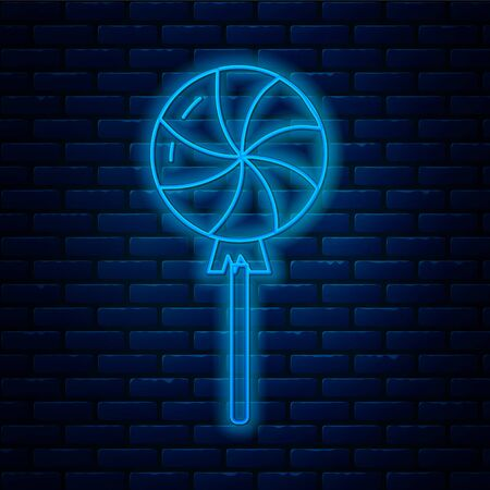 Glowing neon line Lollipop icon isolated on brick wall background. Candy sign. Food, delicious symbol. Vector Illustration
