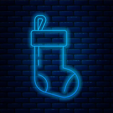 Glowing neon line Christmas stocking icon isolated on brick wall background. Merry Christmas and Happy New Year. Vector Illustration