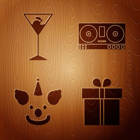 Set Gift box , Martini glass , Clown head and DJ remote for playing and mixing music on wooden background. Vector