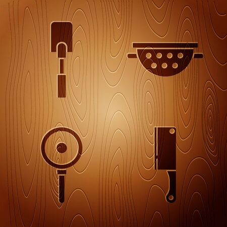 Set Meat chopper , Spatula , Frying pan and Kitchen colander on wooden background. Vector Vettoriali