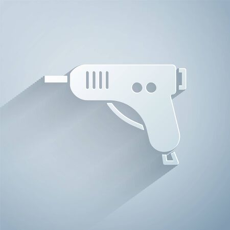Paper cut Electric hot glue gun icon isolated on grey background. Hot pistol glue. Hot repair work appliance silicone. Paper art style. Vector Illustration