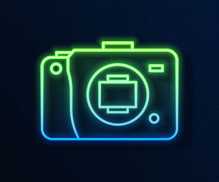 Glowing neon line Mirrorless camera icon isolated on blue background. Foto camera icon. Vector Illustration