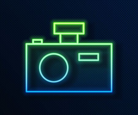 Glowing neon line Photo camera icon isolated on blue background. Foto camera icon.  Vector Illustration Ilustracja