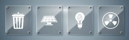Set Radioactive, Light bulb with leaf, Solar energy panel and Trash can. Square glass panels. Vector