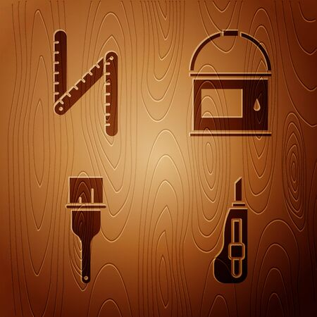 Set Stationery knife, Folding ruler, Paint brush and Paint bucket on wooden background. Vector
