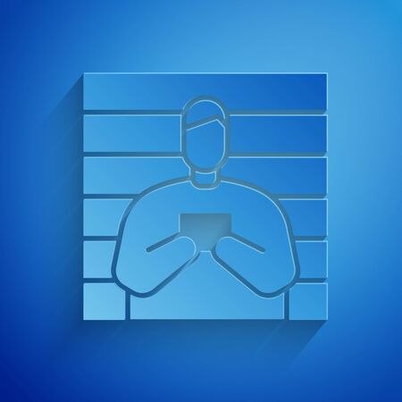 Paper cut Suspect criminal icon isolated on blue background. The criminal in prison, suspected near the board. Paper art style. Vector Illustration