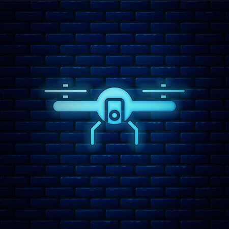 Glowing neon Drone flying icon isolated on brick wall background. Quadrocopter with video and photo camera symbol. Vector Illustration