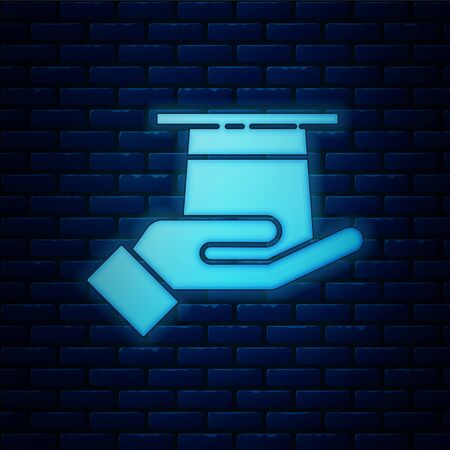 Glowing neon Magician hat in hand icon isolated on brick wall background. Magic trick. Mystery entertainment concept. Vector Illustration