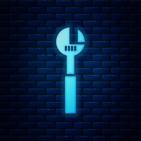 Glowing neon Adjustable wrench icon isolated on brick wall background. Vector Illustration