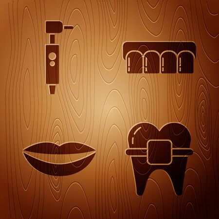 Set Teeth with braces, Tooth drill, Smiling lips and Dentures model on wooden background