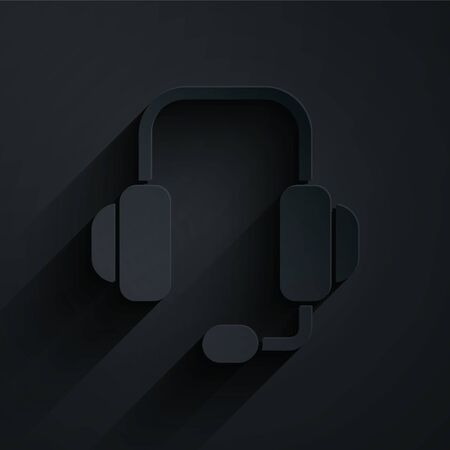 Paper cut Headphones icon isolated on black background. Support customer service, hotline, call center, faq, maintenance. Paper art style. Vector Illustration