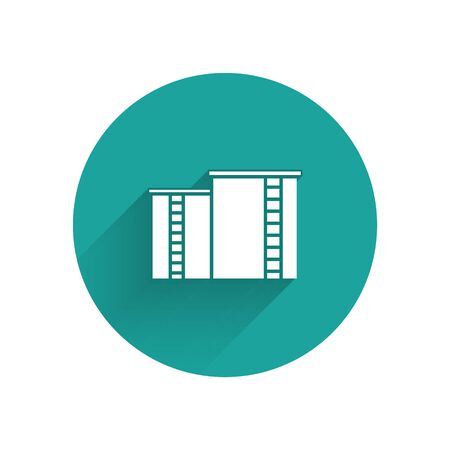 White Oil and gas industrial factory building icon isolated with long shadow. Green circle button. Vector Illustration
