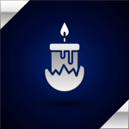 Silver Burning candle in candlestick icon isolated on dark blue background. Cylindrical candle stick with burning flame. Vector Illustration.