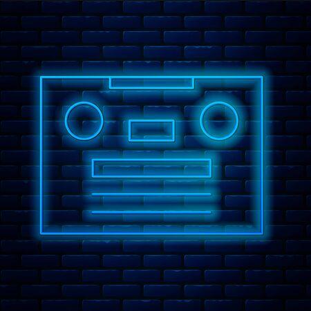 Glowing neon line Retro audio cassette tape icon isolated on brick wall background.  Vector Illustration. Ilustração
