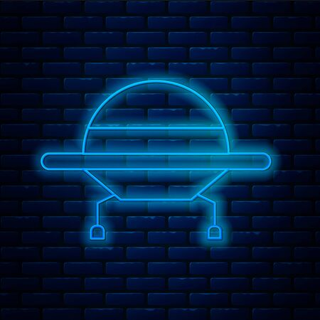 Glowing neon line UFO flying spaceship icon isolated on brick wall background. Flying saucer. Alien space ship. Futuristic unknown flying object. Vector Illustration.