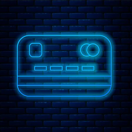 Glowing neon line Credit card icon isolated on brick wall background. Online payment. Cash withdrawal. Financial operations. Shopping sign. Vector Illustration.
