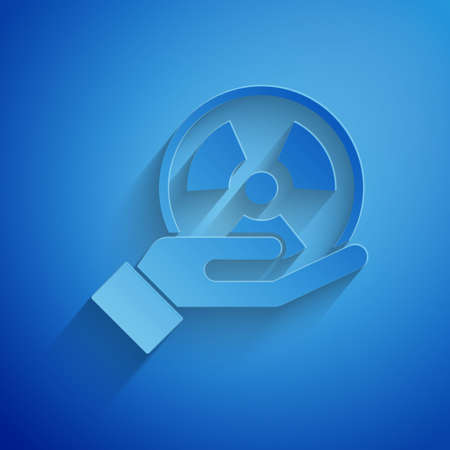 Paper cut Radioactive in hand icon isolated on blue background. Radioactive toxic symbol. Radiation Hazard sign. Paper art style. Vector. Illustration