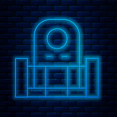 Glowing neon line Grave with tombstone icon isolated on brick wall background. Vector.