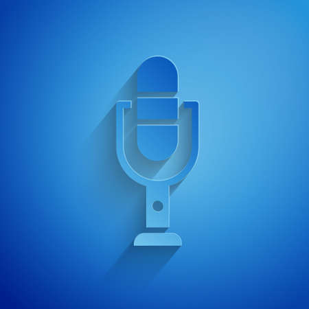 Paper cut Microphone icon isolated on blue background. On air radio mic microphone. Speaker sign. Paper art style. Vector Illustration. Ilustracja