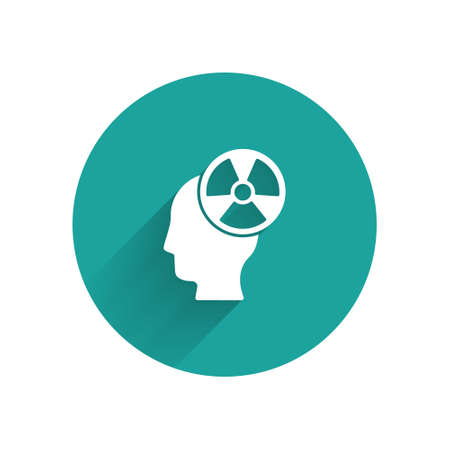 White Silhouette of a human head and a radiation symbol icon isolated with long shadow. Green circle button. Vector.
