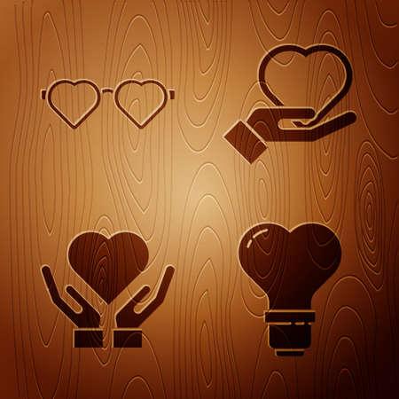 Set Heart shape in a light bulb, Heart shaped love glasses, Heart on hand and Heart on hand on wooden background. Vector