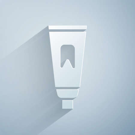 Paper cut Tube of toothpaste icon isolated on grey background. Paper art style. Vector Illustration