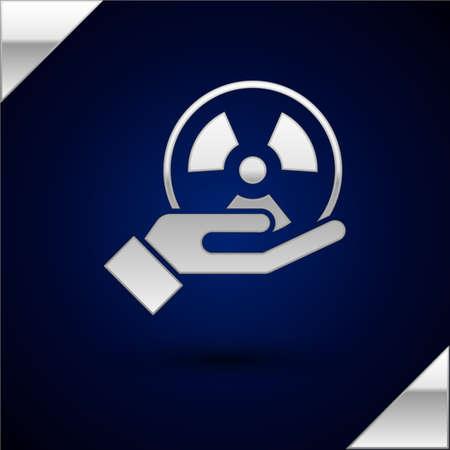 Silver Radioactive in hand icon isolated on dark blue background. Radioactive toxic symbol. Radiation Hazard sign. Vector