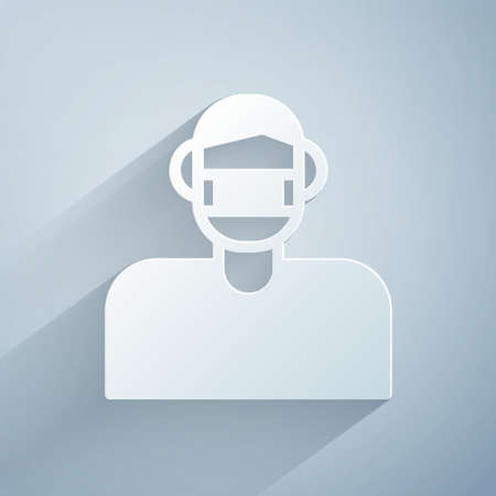 Paper cut Man face in a medical protective mask icon isolated on grey background. Quarantine. Paper art style. Vector