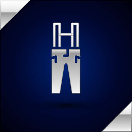 Silver Pants with suspenders icon isolated on dark blue background. Vector