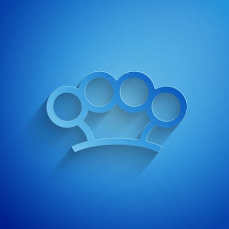 Paper cut Brass knuckles icon isolated on blue background. Paper art style. Vector