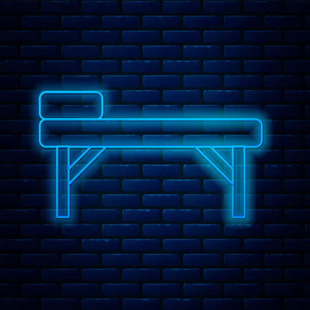 Glowing neon line Massage table icon isolated on brick wall background. Vector