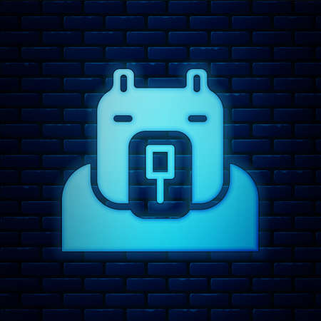 Glowing neon Polar bear head icon isolated on brick wall background. Vector